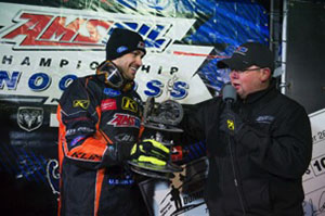 Tremblay accepts the AMSOIL DOMINATOR trophy & $10,000 check from AMSOIL's Jeremy Meyer